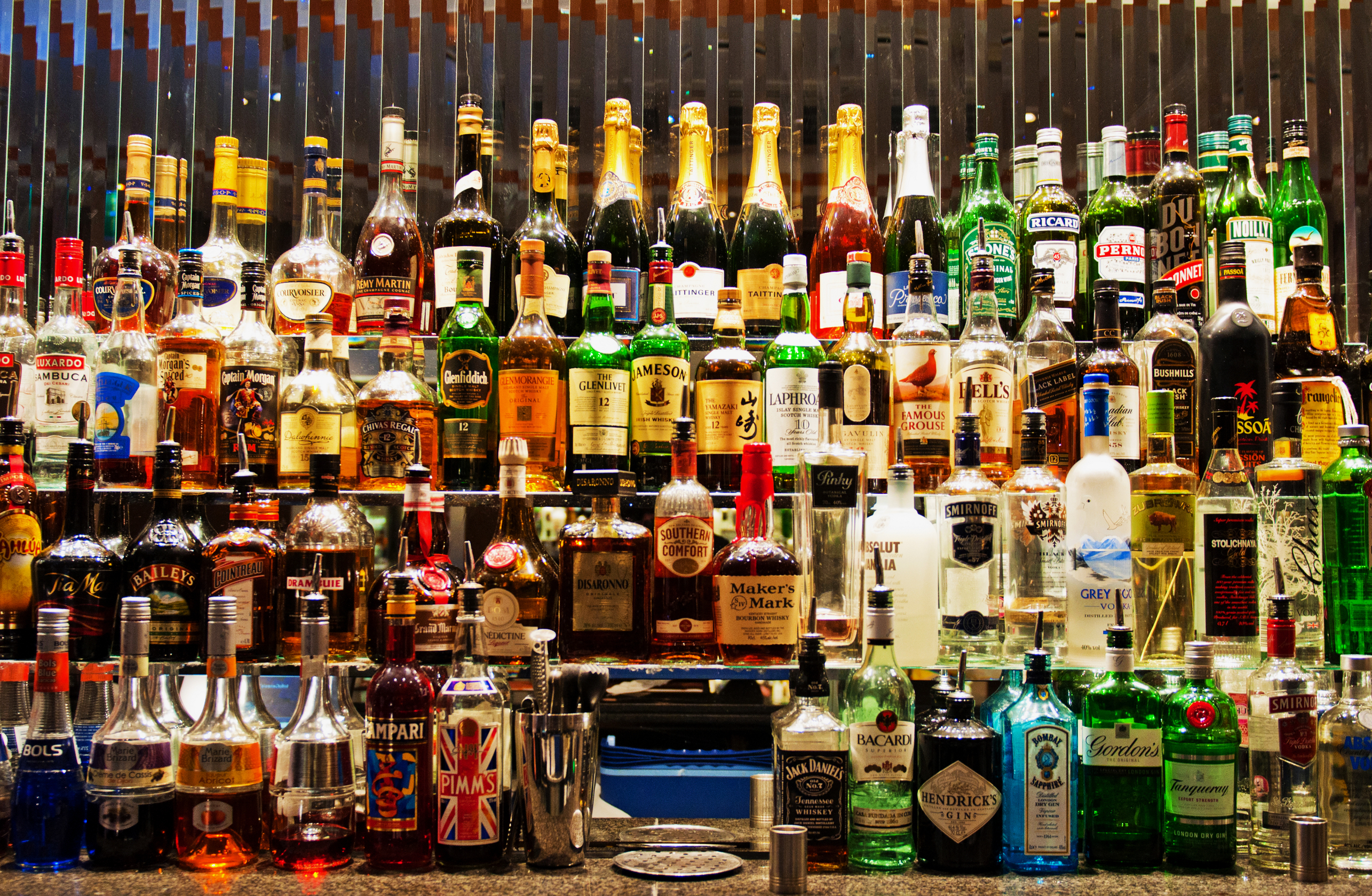 LONDON - JANUARY 26, 2013: liquor bottles at the mask bar inside Strand Palace Hotel in London, UK on January 26, 2013.
